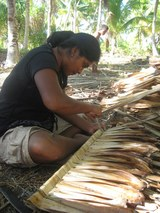 Weaving pandanus leaves for construction work